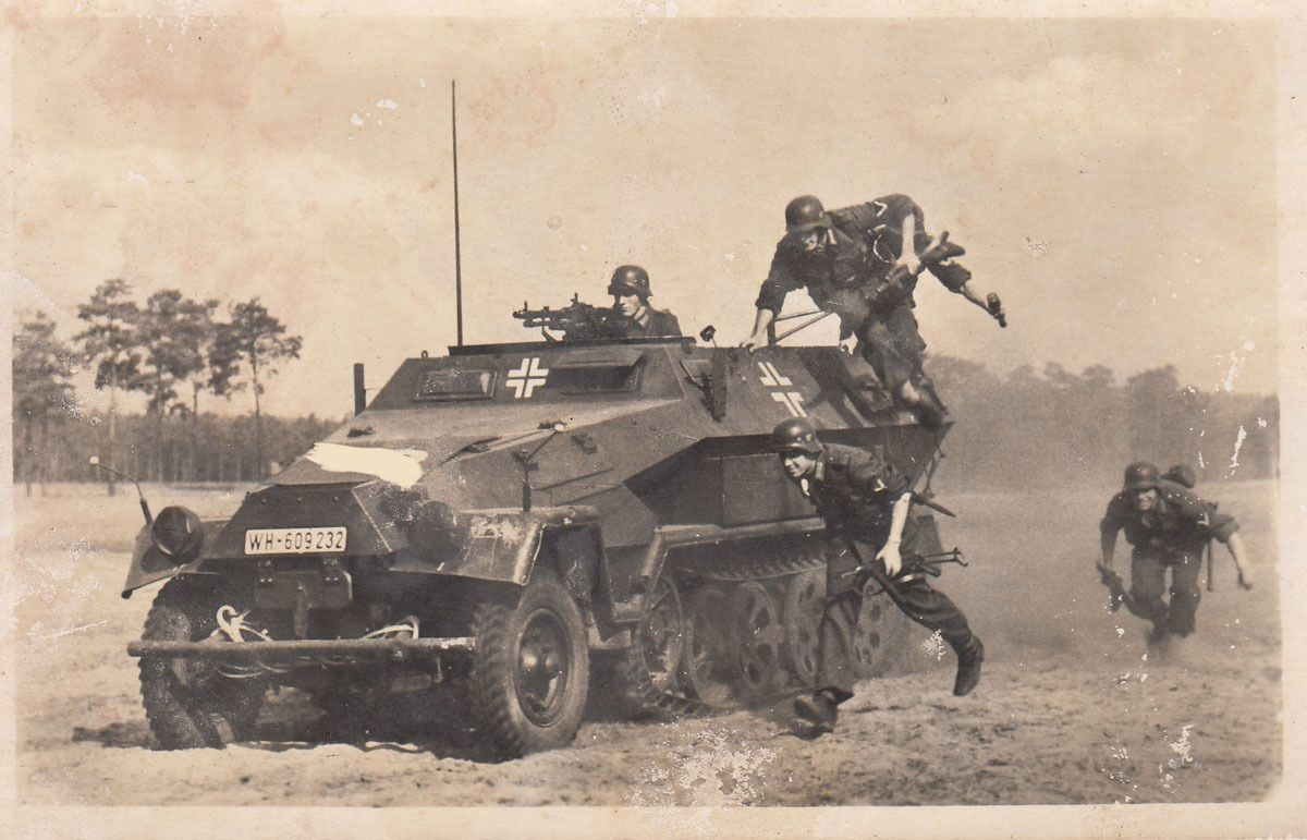 SdKfz 251 and supporting infantry
