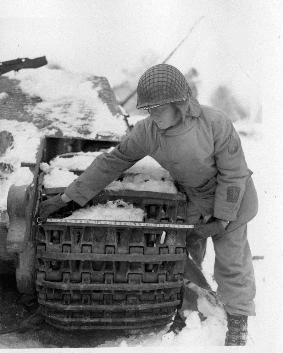 Sergeant 6th US Armored Division George G. Meyer examines damage to Royal Tiger Pz.Kpfw VI Ausf. B. Moinet Belgium 1944 12 1